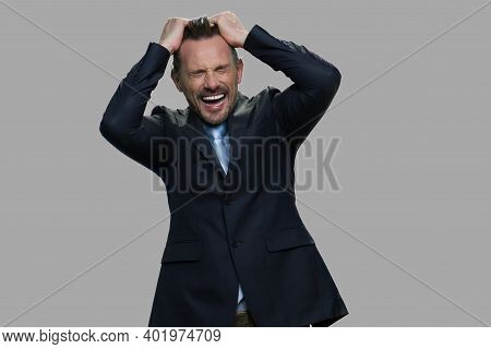 Desperate Businessman Pulling His Hair Out. Frustrated Terrified Middle-aged Businessman Screaming O