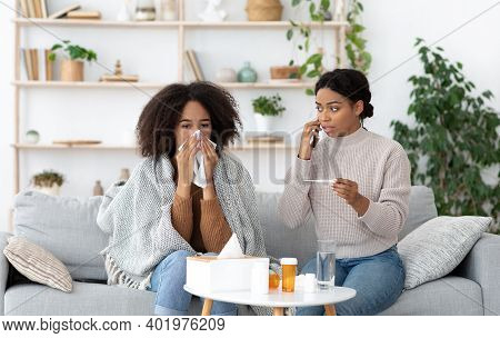 Worry, Care And Treatment Of Disease. Weak Millennial African American Female Wipes Nose With Napkin