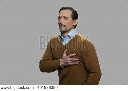 Middle-aged Man Having Sudden Heart Attack. Man Suffering From Chest Pain. How To Survive A Heart At