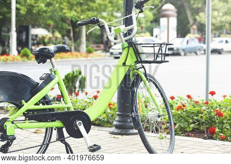 Green Bicycle For Rent In City  Bike For Rent