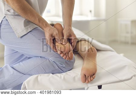 Hands Of Therapist Doing Treatment Of Acupressure Or Manual Massage For Patients Feet