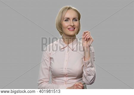 Female Executive Working On Virtual Screen. Pretty Young Business Woman Using Imaginary Interface Ag