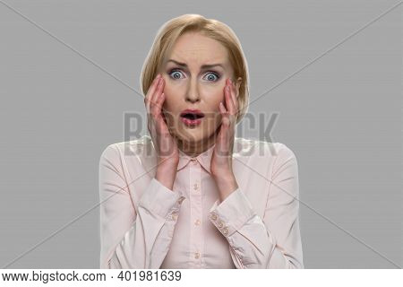Portrait Of Young Frightened Woman. Stunned Scared Caucasian Woman Holding Hands Near Face. Middle A