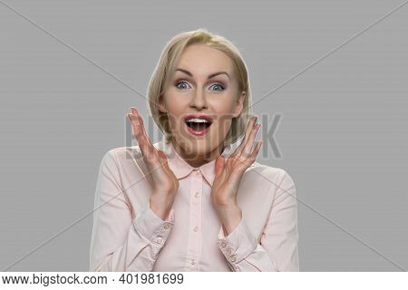 Happy Shocked Young Woman Close Up. Surprised Girl Expressing Happiness. Positive Facial Expressions
