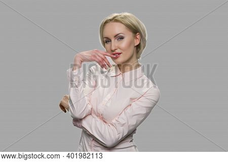 Attractive Young Woman Is Flirting And Seducing. Pretty Lady In Office Shirt Is Expressing Her Sexua
