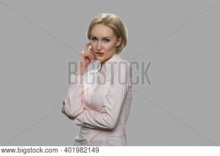 Seductive Business Woman Posing On Gray Background. Portrait Of Sexy Sensual Female Model Looking At