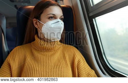 Travel Safely On Public Transport. Young Business Woman With Kn95 Ffp2 Face Mask Looking Through Tra