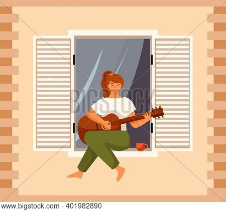 Woman Is Playing The Guitar On Balcony Of Her House. The Musician Is Sitting On The Windowsill. Fema