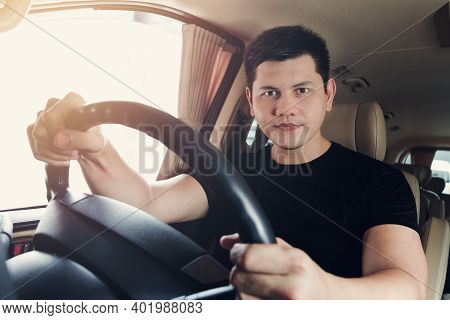 Enjoying His Drive. Handsome Young Man In Black T-shirt Wear Smiling While Driving A Status Car, Vin