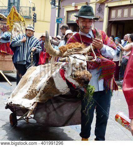 Cuenca, Ecuador - February 22, 2020: Carnival Parade In Cuenca City. Indigenous Village Men With Art
