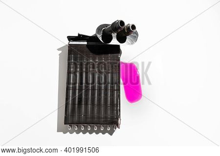 Old Leaky Car Heater Radiator Isolated On White Background. Car Spare Parts. Leaked Coolant