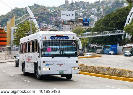 Acapulco, Mexico - May 28, 2017: Old Touristic Coach Bus In The City Street At The Background Of A C
