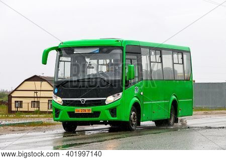Pangody, Russia - June 30, 2020: Green Compact Urban Bus Paz Vector Next In The Town Street.