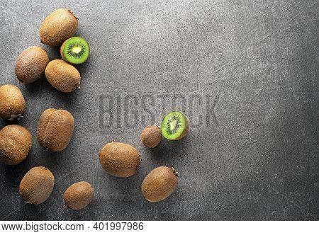 Ripe Whole Kiwi Fruit And Half Kiwi Fruit On Grey Table Background