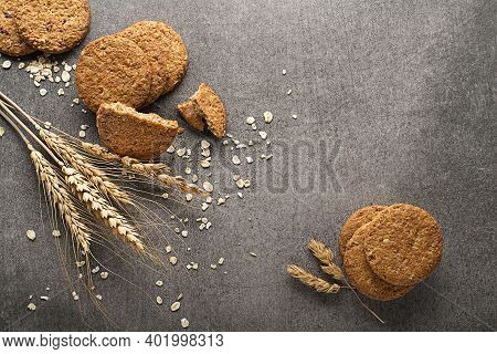Homemade Cereal Oatmeal Cookies On Grey Table Background. Healthy Food Snack Concept. Copy Space