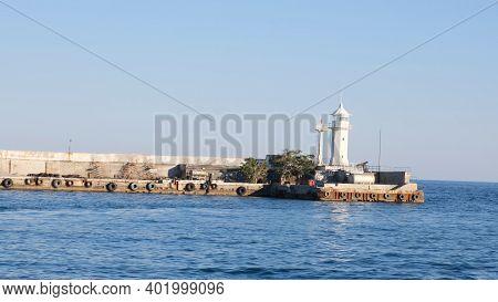 Lighthouse In The Yalta Bay. The City Of Yalta. Crimea.