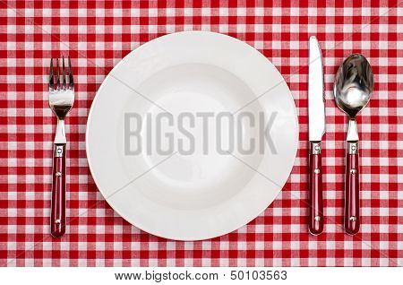 Rural Cover With Plate, Fork, Knife An Spoon On A Table