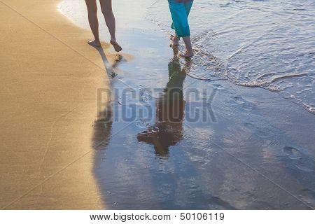Women Walking On Beach During Sunshine