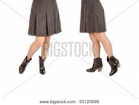 Woman Wearing Polka Dot Mini-Skirt and Black Leather Cowboy Boots
