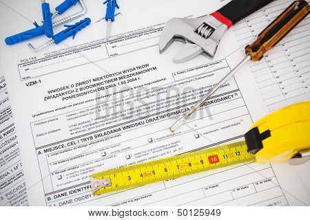 Polish tax form and tools. Credit for home construction. poster