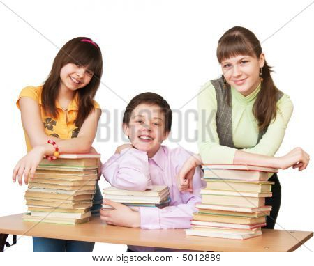 Happy Teenager With Many Books