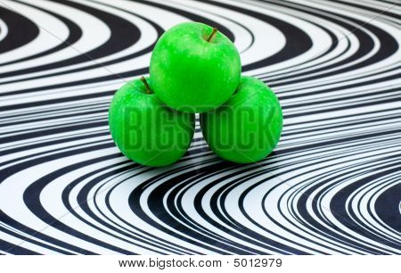 Green apples on black and white glass cutting board poster