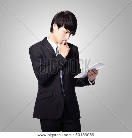 Business Man Reading News On Tablet Pad