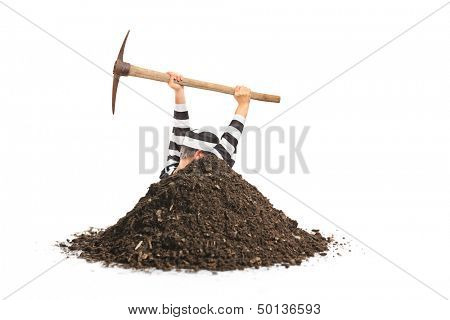 Male prisoner digging a hole and trying to escape isolated on white background