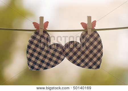 blue heart attached to a clothesline with pin poster