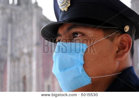Policeman With Mask Stands Guard In Mexico City