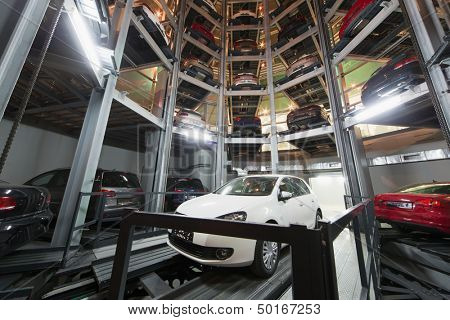 MOSCOW - JAN 11: The Volkswagen Golf on parking lot with a multi-story automated car parking system in tower in Volkswagen Center Varshavka at night on January 11, 2013, Moscow, Russia