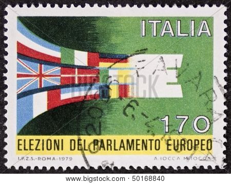 ITALY - CIRCA 1979: a stamp printed in Italy celebrates the first elections to European parliament showing flags of UE member states. Italy, circa 1979