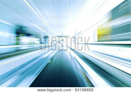 Blurred backround of moving futuristic escalator