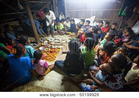 BERDUT, MALAYSIA - APR 8: Unidentified people Orang Asli during a ceremonial dinner in his village on Apr 8, 2013 in Berdut, Malaysia. More than 76% of all Orang Asli live below the poverty line.