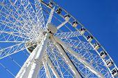 giant ferris wheel in seville, spain poster