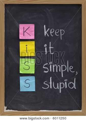 KISS keep it simple stupid - design principle presented with sticky notes and white chalk handwriting on blackboard poster