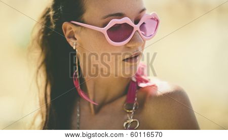 young woman with pink glasses