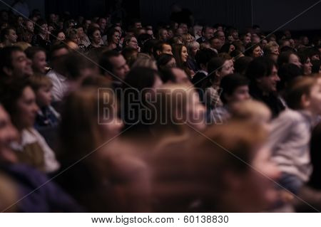 Audience applauding, during a spectacular event