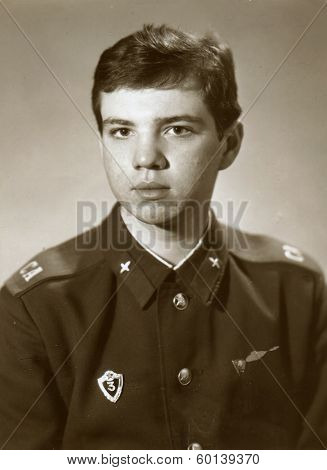 BASHKIRIA, USSR - CIRCA 1987: An antique photo shows studio portrait of a Red Army soldiers, a mechanic 3rd class in uniform.