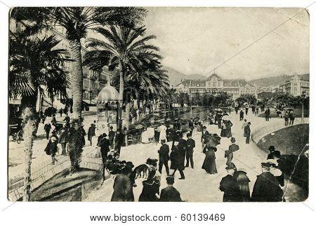 NICE, FRANCE - CIRCA 1909: An antique photo shows walking street near casino