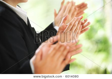 Giving Applause Over Green Background