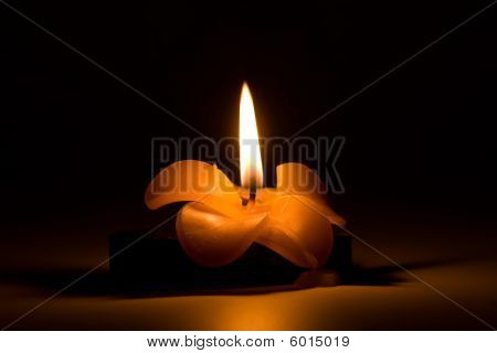 Burning Candle In The Form Of A Flower In Night, In The Dark