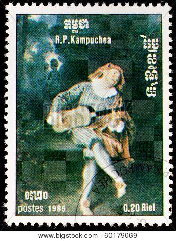 Kampuchea-CIRCA 1985: A stamp printed in the Kampuchea, depicts a harlequin playing guitar, circa 1985