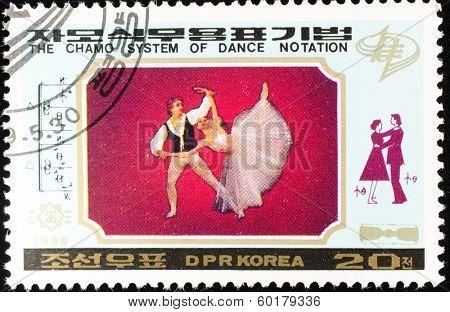DPR KOREA - CIRCA 1989: A stamp printed in DPR KOREA shows the chamo system of dance notation, circa 1989