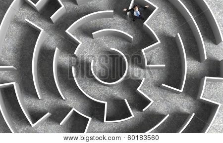 Top view of successful businessman lost in labyrinth