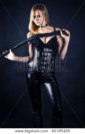 beautiful woman in a corset with a whip