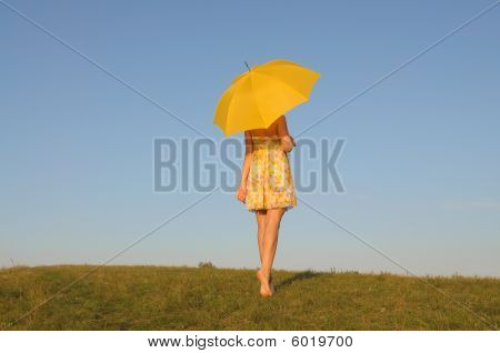 Woman In A Yellow Dress With Umbrella