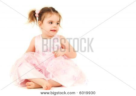 Sitting Princess on the floor in pink dress