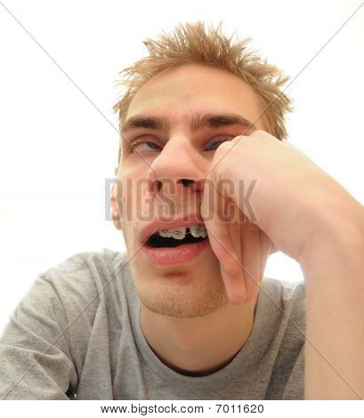 This student is bored out of his mind listening to the dull lecture that is being presented. Isolated on white background with room for your text. poster