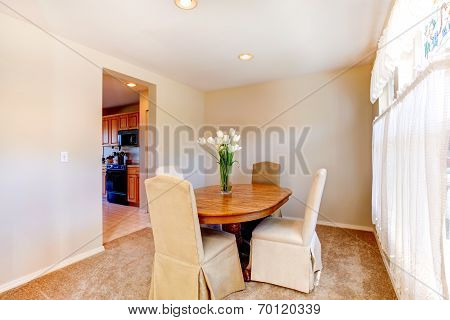 Warm Dining Room In Soft Ivory